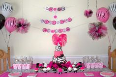 Use zebra print balloons to decorate your zebra inspired cake table. They're fun and affordable.