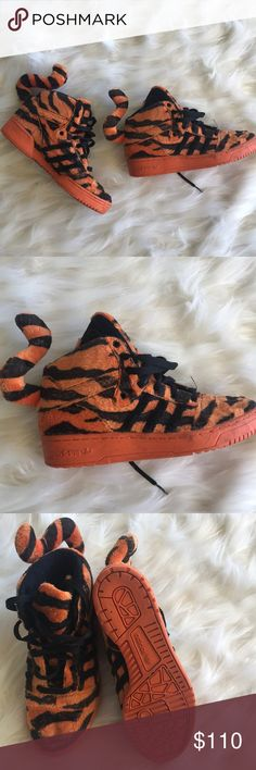 Adidas x Jeremy Scott tiger shoes Rare! Adidas x Jeremy Scott tiger shoes bad ass have been worn but still good condition adidas Shoes Athletic Shoes