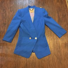 Ted Baker Double Buttoned Blue Blazer Size 0 Super cute Ted Baker blue women's blazer in excellent condition. No stains, tears or even loose threads. Bright blue with a polished finish with silver metallic button closure. There are 3 buttons across the closure in case you overindulge.  This functions great for work or for a casual look as well. Size zero. Any questions, please ask. I can post additional photos if needed as well. ❤️ Ted Baker Jackets & Coats Blazers