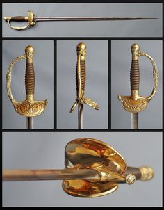 """French Infantry Officer Sword. This is an Infantry Officer sword from Napoléon III's period, the 1860 pattern. This particular sword is engraved with """"Manufacture Impériale de Chatellerault Officier de la Garde Modèle 1860"""", The grip is made of wood and the sword has a brass hilt with one branch and a folding back guard, engraved with a crown """"N"""" on it. Copyright © 2013 Swords Collection"""