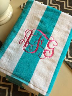 Monogrammed Beach Towel by RayneDropsBoutique on Etsy https://www.etsy.com/listing/231415146/monogrammed-beach-towel
