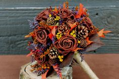 fall wedding bouquets - pinecones instead of the few roses and lose the purple