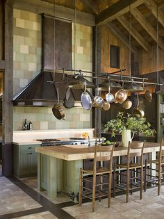Love the look of hanging pots and pans, if I cooked I'd do it in my own kitchen one day.