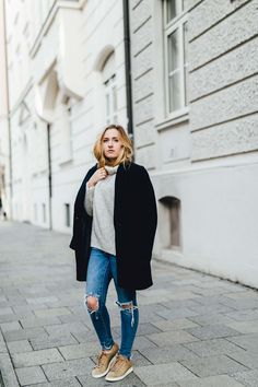 Hidden in Knit blog post by Viviane Lenders on For Your Life fyl-blog-com wearing a chunky turtleneck knit jumper by Zara, navy wool coat by Mint and Berry, ripped denim Jeans by Vila and Pony Hair Adidas Stan Smith sneaker. #streetstyle #fashion #blogger #minimal #style
