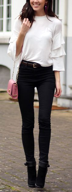 Ruffle sleeves, black and white outfit with a pop of pink! Pink crossbody bag on sale by Gigi New York!