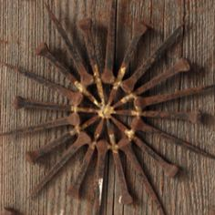 Old rusty work nails - made into an art wall hanging.