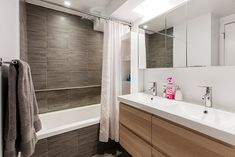 Install a slim built-in between the nook of the vanity and tub to store towels and bath necessities.