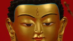 Detail of Buddha's gold leaved face