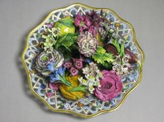 A TROMPE L'OEIL DISH FILLED WITH FLOWERS.Meissen  19th Century