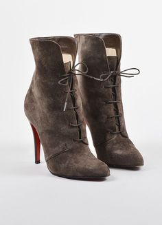 These chic boots are constructed of creamy suede. Pointed toe. Lace up split shaft. Stacked stiletto heel. Tonal stitching. Iconic red outsoles. Size: 36.5 Made in: Italy Color: Dark Brown Fabric Cont
