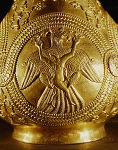 4-03-05/24 PROTOBULGARIAN ARTFORM: GOLDWORK 9TH The treasure of Nagyszentmiklos.The gold treasure found in 1799 in Nagyszentmiklos (now Sinicolaul in Romania)consists of 23 pure gold vessels.The medallion on this gold pitcher shows a woman with flowers in her hands being carried off by an eagle. Kunsthistorisches Museum, Antikensammlung, Vienna, Austria   Thracian