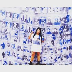 This is my sister who wore a really long custom printed shirt as a dress in front of the 5 x 5 meters backdrop I made. Took me a few days to make.  Brought plain white material for $2 a meter in Cabramatta then sowed it together. I printed out stencils of all the rappers who were from the Westside on A2 stencils in black and white and cut them all out by hand all from office works then spray painted them onto the massive backdrop with spray paint from Bunnings suitable for material.