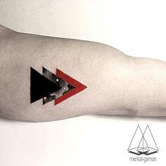 Mentat Gamze • Istanbul, Turkey dotwork geometric triangles tattoo
