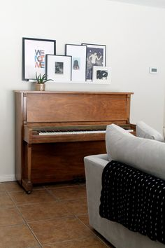 Ideas for decorating above the piano.  Love photo ledge and plant (except larger plant needed)