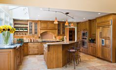 Anyone would love to have this kitchen. I love the cabinets surrounding the kitchen island. #kitchen #cabinets #kitchenisland