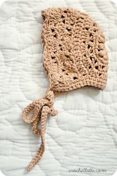 crochet baby bonnet - liked the final product.  Definitely needed the extra 2 rows