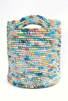 Laundry basket made from recycled plastic bags.