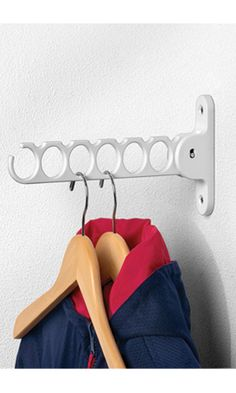 "Solutions Mountable Hanger Holder    Description:    The Hanger Holder provides valuable hanging space for ties, belts, and clothes on hangers. It conveniently folds up and down for permanent or temporary use. Easily holds a minimum of 6 hangers. Perfect in the bedroom or in the laundry room to hang clothes while they dry.     Details:    •Sku# 26005     •Mounted piece is 5""H, folded down it is 11 3/4""H.    •Holds up to 6 hangers.  •Ideal for bedroom or laundry room.  •Swing arm for easy…"