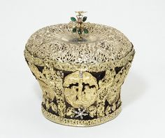A silver-gilt Armenian mitre, 1650–1750; decorated with scenes of the Annunciation, the Baptism of Christ the Last Supper, the Entombment and the Resurrection; a symbol of Christ the King, and of the priesthood; symbolically equated with a 'helmet of salvation'. (Victoria & Albert Museum)