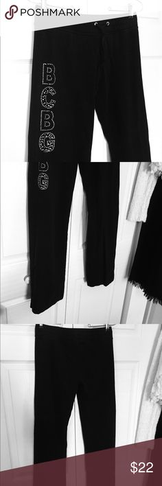 "BCBGMAXAZRIA Black Lounge Black sweatpants with bling logo down the right leg.  Boot cut leg and drawstring waist.  Very slight fading of waistband, otherwise excellent condition.  Approx 37"" long x 14"" waist.  95% cotton, 5% spandex. BCBGMaxAzria Pants Track Pants & Joggers"