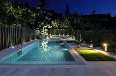 Modern backyard with cozy lighting