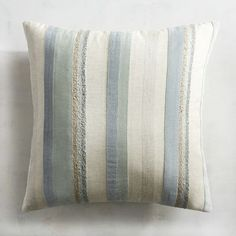 Stripes are traditional, versatile and never go out of style. Our cotton/linen-blend pillow features rows of contrasting thickness that make a calming statement in quiet blues and creams.