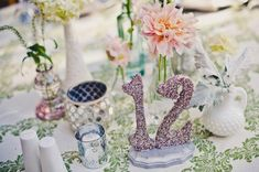 Lovely little hodgepodge of vases, photos by Wild Poppy