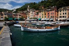 Portofino, Italy -  Portofino is a small Italian fishing village, comune and tourist resort located in the province of Genoa on the Italian Riviera. The town is crowded round its small harbour. The most impressive thing about Portofino is the lifestyle.