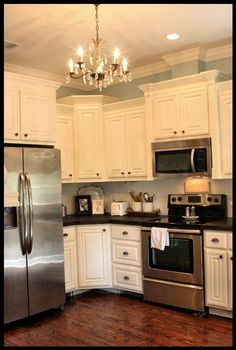 color scheme, white cabinets, very dark counter, wooden floors