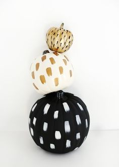 White, gold, black painted pumpkins