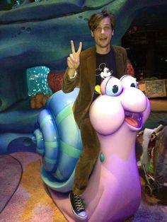 Matthew Gray Gubler riding a snail...of course.