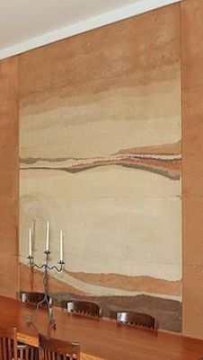 Oxides (I assume) rammed so beautifully into a panel of rammed earth it looks like a painting. Fantastic.