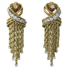 Mid Century Gold Diamond Earrings | From a unique collection of vintage more earrings at http://www.1stdibs.com/jewelry/earrings/more-earrings/