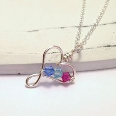 Keep your family close to your heart with this lovely Sterling Silver customised birthstone necklace. Handcrafted with Sterling Silver wire and your choice of up to 3 Swarovski crystals. A treasured gift for Mothers and Grandmothers. Wire Wrapped Jewelry, Wire Jewelry, Handmade Jewelry Designs, Handmade Jewellery, Jewellery Box, Jewelry Shop, Jewelry Ideas, Silver For Jewelry Making, Golden Jewelry