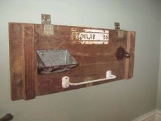 Lid from an Ammo box; grain scoop, hook...towel bar and holder for soap or extra roll of toilet paper.