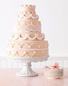 Piped Wedding Cake, Swags made from piped royal icing give this fondant-covered creation a 1950s feel, while tiers of varying heights (a big trend right now) make it current. -  from Wendy Kromer, contributing editor at Martha Stewart Weddings and owner of Wendy Kromer Confections in Sandusky, Ohio.