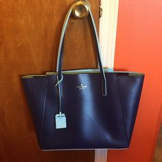 Kate Spade Ivy drive large loryn. Kate spade- size 10.7Hx14.8Wx5.4D drop- 8.3 handle. Tote with zip top closure- interior pockets- small exterior pocket on back. Color/ French navy/blue hydrangea. Great for everyday use. In EXCELLENT condition bought 2 months. Worn 3times. kate spade Bags Shoulder Bags