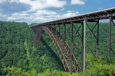 West Virginia | New River Gorge Bridge  At 876 feet above the New River, the New River Gorge bridge is the place for seeing stunning views of the West Virginia landscape. Stretching 3,030 feet in length, the bridge is the second largest single-span steel arch in the Western Hemisphere. Year-round walking tours — during which guests are fastened onto a safety cable in order to cross the bridge — are typically 2-3 hours in length.