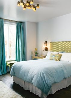 A bright nature-inspired blue and acid green colour scheme sets a soothing tone in a bedroom.