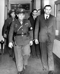 http://touch.courant.com/#section/-1/article/p2p-79985047/?related=true uniformed military police escort Erich Gimpel, right foreground, and William C. Colepaugh, background, into court at Governors Island, N.Y. March 3,1945, for another trial session. Both were subsequently convicted as Nazi spies and sentenced to die by hanging.