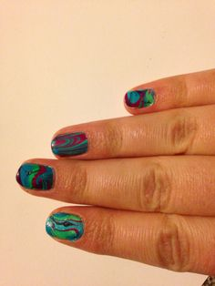 Water marble nails. Done using Barry M
