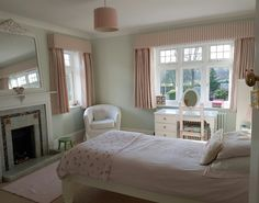 Pink and duck egg blue girls bedroom, walls in Farrow and Ball Pavilion Blue, curtains Susie Watson Pale Rose and ivory Cambridge stripe with pom poms