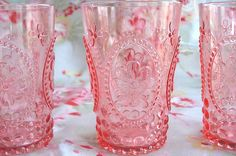 pretty pink pressed glass, not sure what the correct term is. Depression glass?