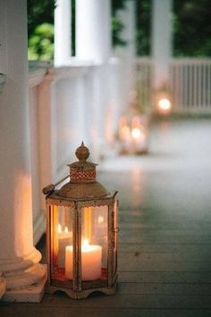 Great lanterns on a wrap-around porch! Candle Impressions has Flameless Outdoor Candles that would be perfect for this! Candle Lanterns, Candle Sconces, Porch Lanterns, Fire Candle, Large Lanterns, Metal Lanterns, Color Splash, Deco Restaurant, Vibeke Design