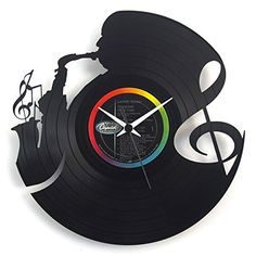 Vinyluse Music Clock. Clock made of original-engraved vinyl discs. The label colour at the centre of the disc is random.