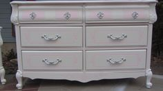 French Provincial dresser. Hand painted in swan white with pink lemonade accents, silver handles, and an iridescent white finish. Perfect for a princess! Refinished by Kelly's Creations.  http://www.facebook.com/pages/Kellys-Creations/524028237619793