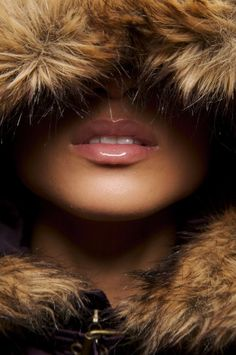 eyes covered by furr. From all I could see of her face, she was not amused. Her lips crinkled lightly. The smirk sent me right over the moon.