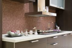 #Kitchen Idea of the Day: Modern Dark Wood Kitchen with a copper-colored mosaic tile backsplash