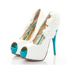 Turquoise and White pumps... while turquoise is my favorite color, I think these would be gorgeous with a wine/plum or navy blue (for Wedding Part 2)