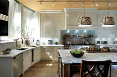 This is beautiful! The only thing I would've changed is the pendant lights.  Not sure if I like them for the kitchen.
